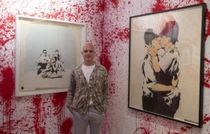 Curator Steve Lazarides poses for a photograph at the Banksy: The Unauthorised Retrospective exhibition at Sotheby's S2 Gallery in London June 6, 2014. REUTERS/Neil Hall
